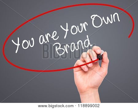 Man Hand Writing You Are Your Own Brand With Black Marker On Visual Screen