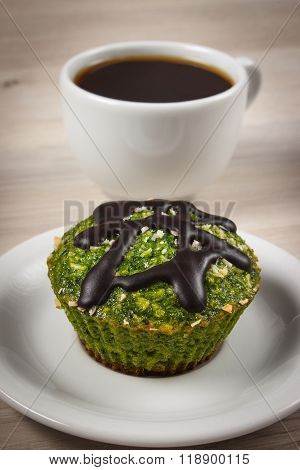 Fresh Muffin With Spinach, Desiccated Coconut, Chocolate Glaze And Cup Of Coffee, Delicious Healthy