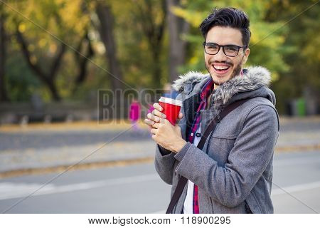 Young man with a cup of coffee in New York city.