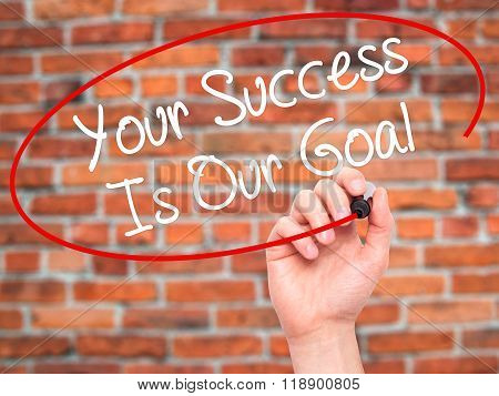 Man Hand Writing Your Success Is Our Goal With Black Marker On Visual Screen
