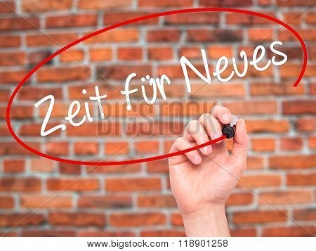 Man Hand Writing Zeit F????'Â?r Neues (time For Something New In German) With Black Marker On Visual