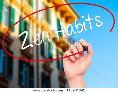 Man Hand Writing Zen Habits With Black Marker On Visual Screen