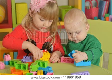 boy and  girl of playing with cubes