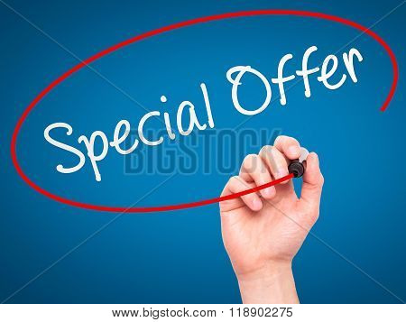 Man Hand Writing Special Offer With Marker On Transparent Wipe Board