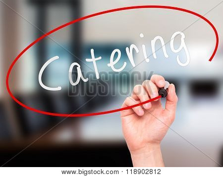 Man Hand Writing Catering With Marker On Transparent Wipe Board