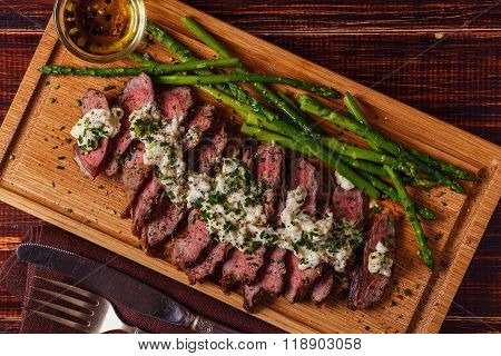 Steak With Blue Cheese Sauce Served With Asparagus.