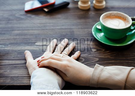 woman is holding her hands with a ring