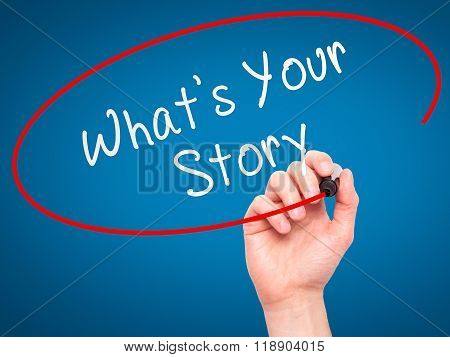 Man Hand Writing What's Your Story With Marker On Transparent Wipe Board