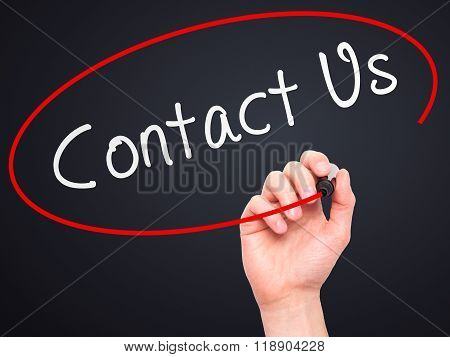 Man Hand Writing Contact Us With Marker On Transparent Wipe Board Isolated On Black