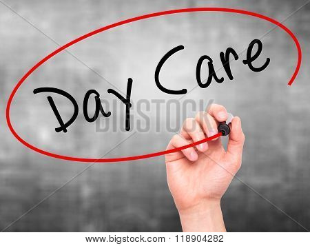 Man Hand Writing Day Care With Marker On Transparent Wipe Board Isolated On Grey