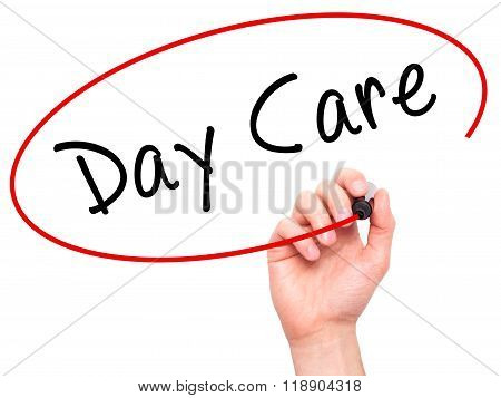 Man Hand Writing Day Care With Marker On Transparent Wipe Board Isolated On White