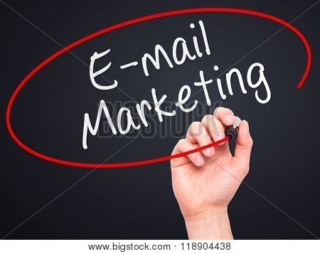 Man Hand Writing E-mail Marketing With Marker On Transparent Wipe Board Isolated On Black