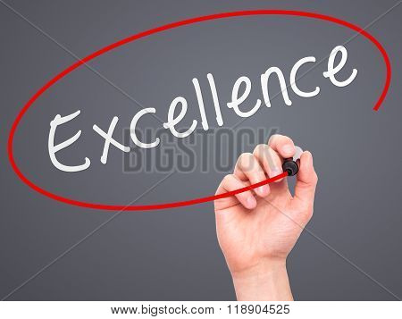 Man Hand Writing Excellence With Marker On Transparent Wipe Board Isolated On Grey