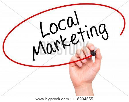 Man Hand Writing Local Marketing With Marker On Transparent Wipe Board