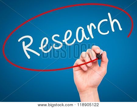 Man Hand Writing Research With Marker On Transparent Wipe Board