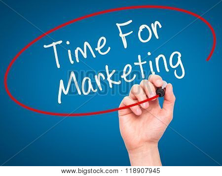 Man Hand Writing Time For Marketing With Marker On Transparent Wipe Board