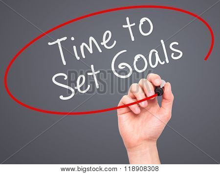 Man Hand Writing Time To Set Goals On Visual Screen