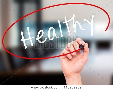 Man Hand Writing Healthy With Marker On Transparent Wipe Board