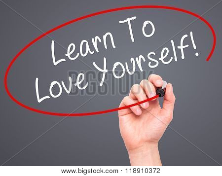 Man Hand Writing Learn To Love Yourself With Marker On Transparent Wipe Board