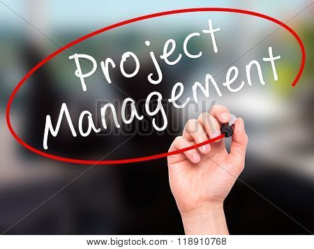 Man Hand Writing Project Management With Marker On Transparent Wipe Board