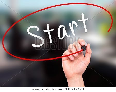 Man Hand Writing Start With Marker On Transparent Wipe Board