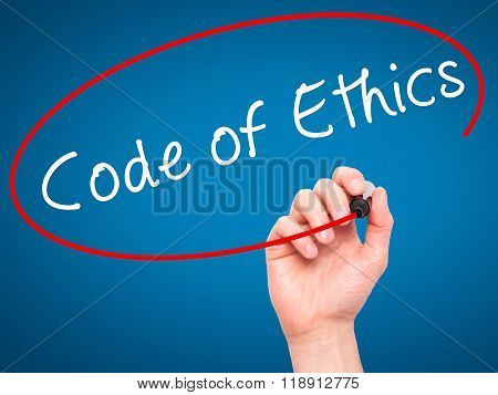 Man Hand Writing Code Of Ethics With Black Marker On Visual Screen