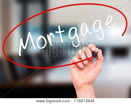 Man Hand Writing Mortgage With Black Marker On Visual Screen
