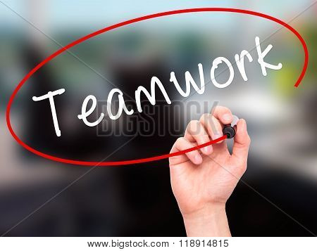 Man Hand Writing Teamwork With Black Marker On Visual Screen