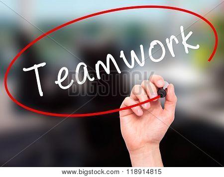 Man Hand Writing Teamwork With Black Marker On Visual Screen