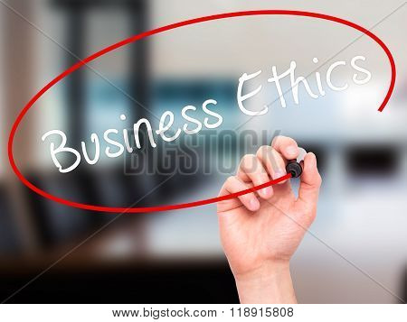 Man Hand Writing Business Ethics With Black Marker On Visual Screen