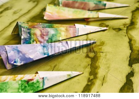 Paper Colorful Planes On A Wood Table