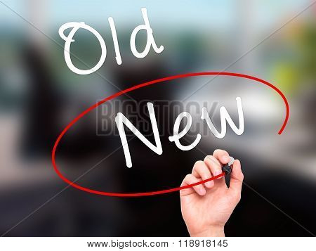 Man Hand Writing And Choosing New Instead Of Old With Black Marker On Visual Screen