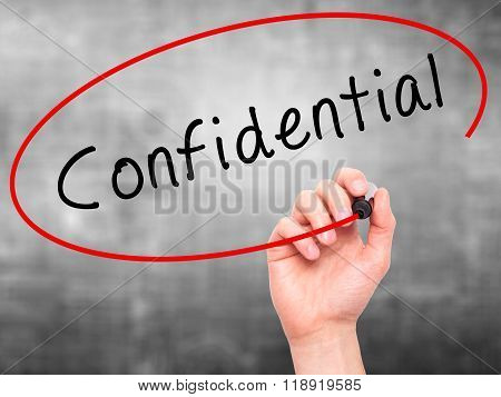 Man Hand Writing Confidential With Black Marker On Visual Screen