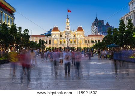 HO CHI MINH CITY, VIETNAM - February 14: People walking in the park in front of the People's Committee Building ( City Hall ) building at dusk on February 14, 2016 in Ho Chi Minh City, Vietnam.
