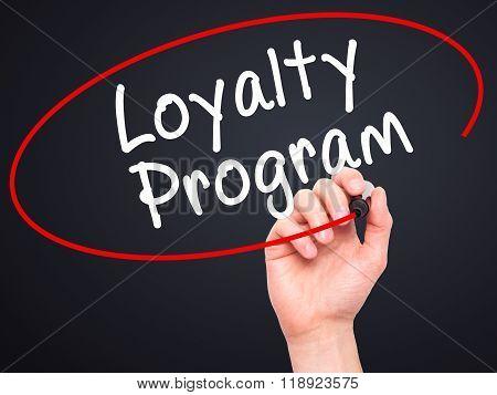 Man Hand Writing Loyalty Program With Black Marker On Visual Screen