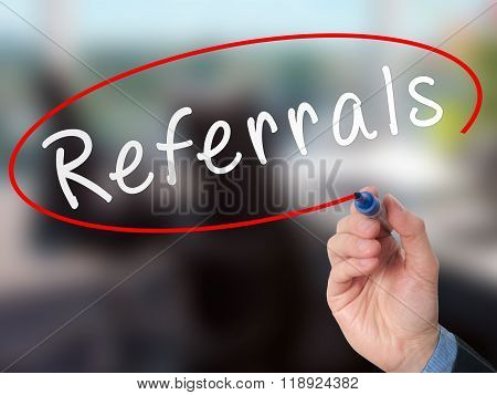 Man Hand Writing Referrals With Marker On Virtual Screen