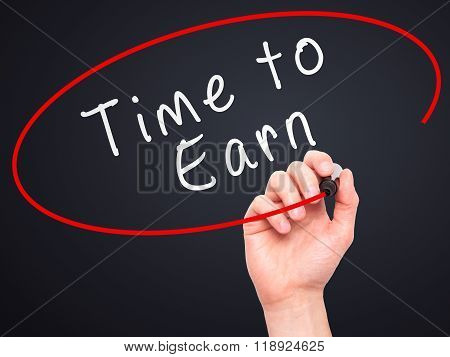 Man Hand Writing Time To Earn With Marker On Transparent Wipe Board