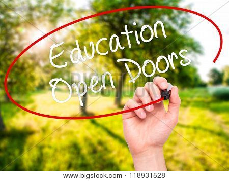 Man Hand Writing Education Open Doors With Black Marker On Visual Screen