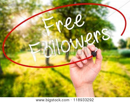 Man Hand Writing Free Followers With Black Marker On Visual Screen
