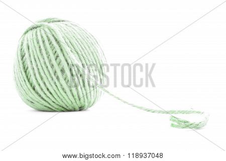 Green braided clew, knitting yarn roll isolated on white background