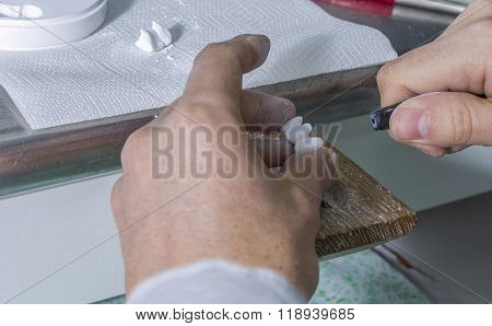 Dental Technician Using Dental Burs With Zirconium Teeth.