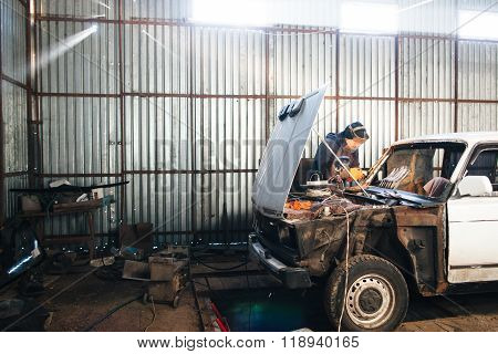 Mechanic repair and service car in garage