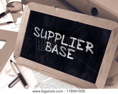 Supplier Base Handwritten on Chalkboard.