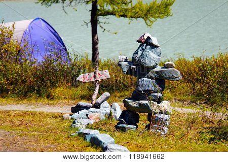 Stone idol on the shore of lake AK-Kem