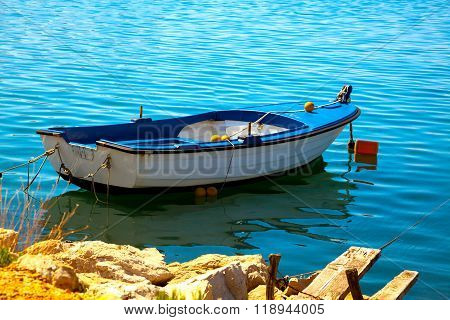 One Fishing Boat Floating On The Water