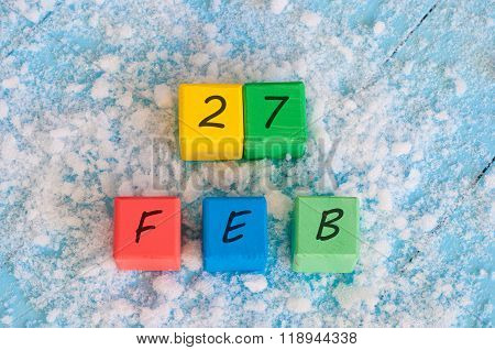February 27th. Calendar date on color wooden cubes with marked Date 27 of february. Winter end conce