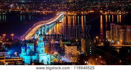 Beautiful Landscape Of Evening City Saratov With Church And Bridge Through The Volga River, Russia,