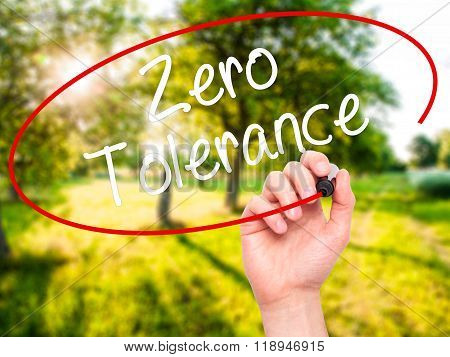 Man Hand Writing Zero Tolerance With Black Marker On Visual Screen
