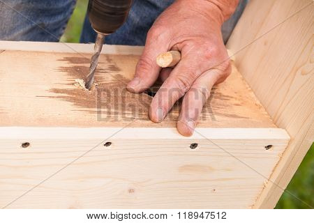 Carpenter Works With Drill, Close-up Photo