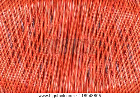 closeup of copper wire - red background